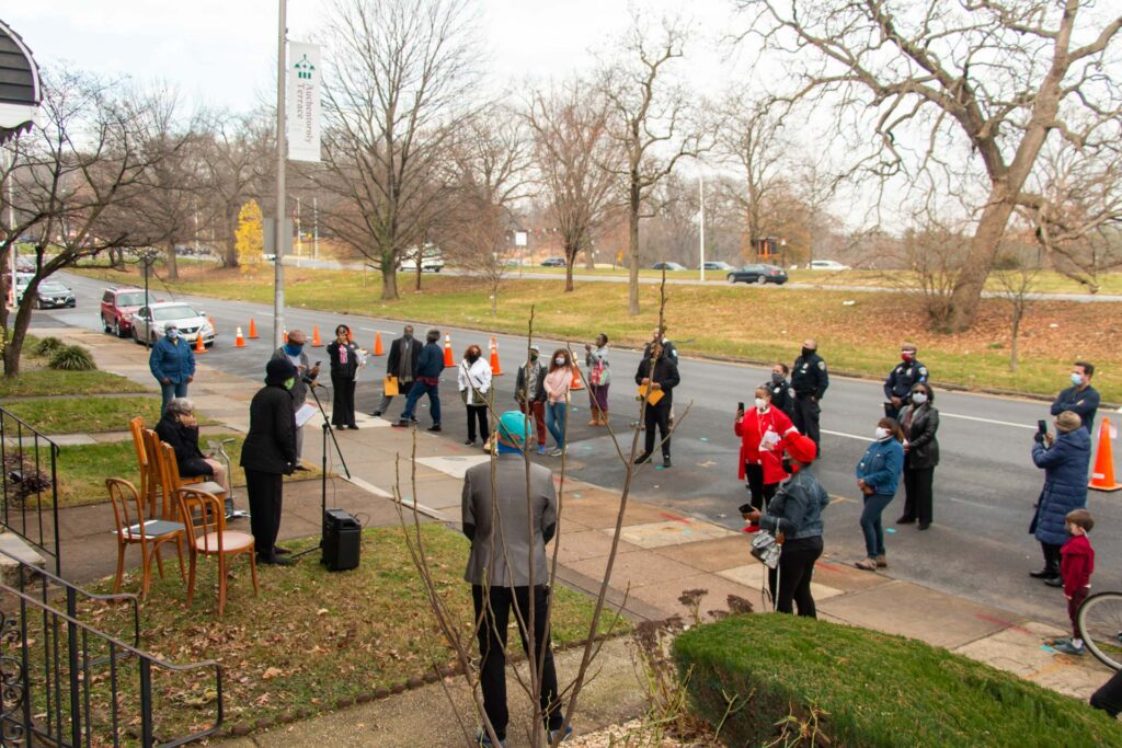 A crowd of residents stand along Auchentoroly Terrace to listen to Ms. Barbara speak