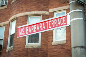 """Ms. Barbara Terrace"" ceremonial street sign"